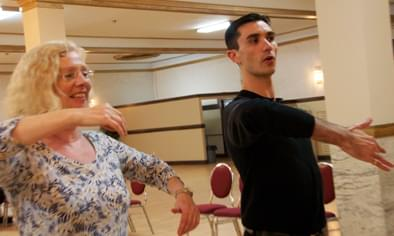 a ballroom instructor teaching his student