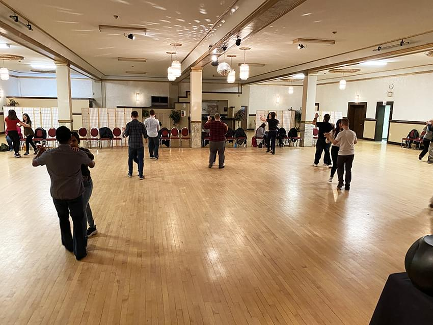 9 pairs of people during there ballroom dance lesson