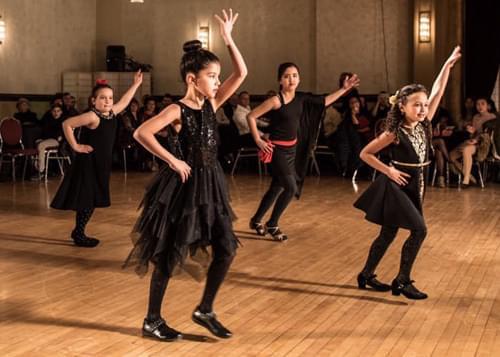 4 childrens performing a ballroom dancing