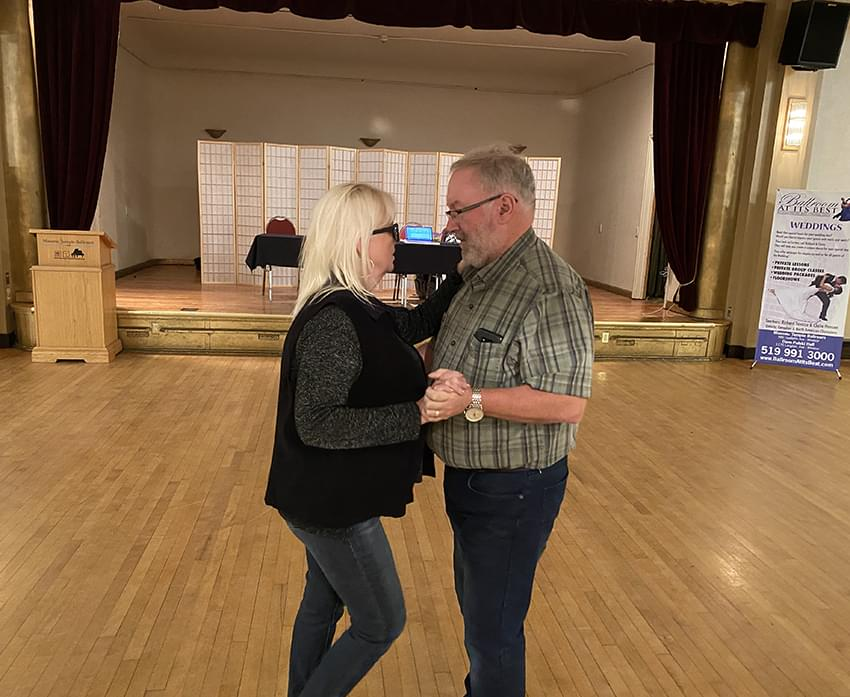2 adults learning a ballroom dancing
