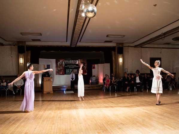 3 women performing a ballroom dancing event